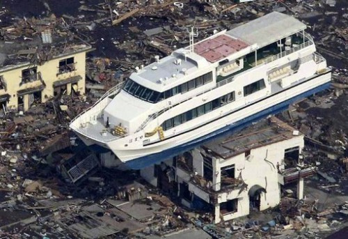 This aerial shot shows a pleasure boat sitting on top of a building amid a sea of debris in Otsuchi town in Iwate prefecture on March 14, 2011 following the March 11 tsunami. A nuclear power plant damaged by An explosion rocked an earthquake-hit nuclear plant Monday, as Japan struggled to avert a catastrophic reactor meltdown caused by a quake and tsunami feared to have killed more than 10,000. JAPAN OUT RESTRICTED TO EDITORIAL USE AFP PHOTO / YOMIURI SHIMBUN ALTERNATIVE CROP (Photo credit should read YOMIURI SHIMBUN/AFP/Getty Images)